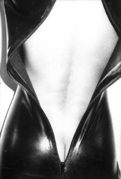 """: """"David Bailey ph. - Female's body detail wrapped in a leather dress with zipper 1976 """""""