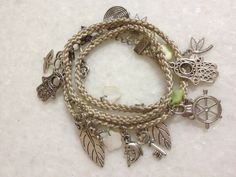 Thread Charm Bracelets by hebaalayyan on Etsy, $12.00. Love this.