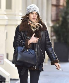 Cosy cover-up: The 32-year-old fashionista wrapped up in a cool leather aviator jacket with a heavy furry brown trim and collar