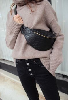 black denim jeans button detail, knit and bumbag