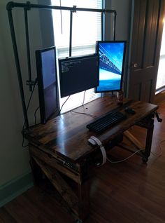 Iron and wood desk with built in monitor mounts. Could be extra nice as an adjustable standing desk!