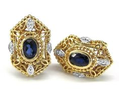 Ladies 14kt  yellow gold diamond and blue sapphire earrings. Set in earrings are 2 oval cut genuine blue sapphire gemstones. Also set in earrings are 4 brilliant round cut diamonds weighing a total of .02ct.