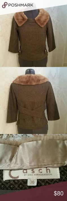 RARE BEAUTIFUL CASCH GRO VINTAGE WOOL&MINK TOP This darling top to is absolutely gorgeous!  !!!! It is made by the designer Casch Gro Abrahamsson.  Real mink collar.  Fully lined, wool that has a unique tie design that criss crosses in the back and comes around and buttons in the front.  3/4 sleeves.  Side zipper.  SUPER CUTE FOR THE FALL AND WINTER . From armpit to armpit is 17 inches, from shoulder to hem is 19 inches, lying flat across the front is 18 inches at the waist from shoulder to…