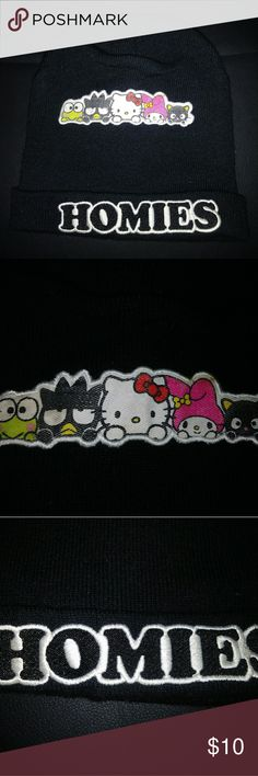 Hello Kitty Homies Hat Basic black hat with hello kitty and friends on the top and homies along the fold. Fits adults or kids. Small stain that can easily be washed out. Hello Kitty Accessories Hats