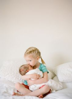 Adorable Sister with Cutest Newborn