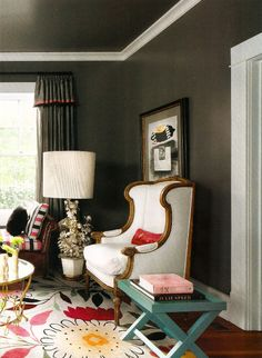 Love this! Love the Rug Company rug to lighten all that chocolate up...and the white upholstery, good looking!