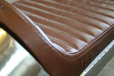 Image result for upholstery seat cafe racer