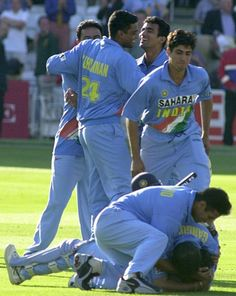 July 13, 2002: The venue is Lord's. The date is 13 July 2002. Shown here, moments after the thrilling game, Sourav Ganguly and team mob the star of the match, Mohammad Kaif after he leads India to a remarkable victory. Click the picture for the scorecard,