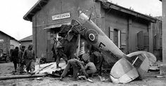 """American soldiers examine the wreckage of British Spitfire which crashed in the town of Attrezzeria, near Anzio. The """"attrezzeria"""" building in background, which is a tool shop, may be the building the plane crashed into near Anzio, Italy (January Aircraft Photos, Ww2 Aircraft, Military Aircraft, The Spitfires, Ww2 Pictures, Supermarine Spitfire, American Soldiers, Royal Air Force, Japan"""