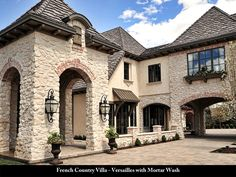"Coronado Stone French Country Villa Stone in ""Versailles"" with mortar wash. I love the use of the stone, brick accents, bronze standing seam metal canopy and the roof. French Country Exterior, French Country Bedrooms, French Country House, Country Chic, Stucco And Stone Exterior, Brick And Stone, Austin Stone Exterior, Coronado Stone, Backyard Canopy"