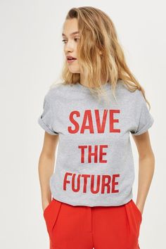 Speak your mind with a statement piece of clothing. This grey marl tee comes with a bold 'SAVE THE FUTURE' slogan to the front in red. Guaranteed to turn heads your way, we've amplified the look by pairing with red trousers to co-ordinate the look.