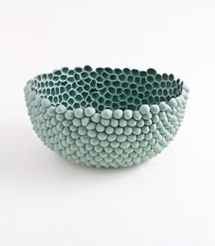 maybe opposite? try: thick coil bowl, divets/craters formed w/tool. enhance edged with pinched ribbon. glaze: engobe outside (+ in?), spot glaze in some craters (brush? glaze inside?), could also glaze outside/inside/not rim and fire upside down? - play with scale: 10-16 small pinch pots pieced together?
