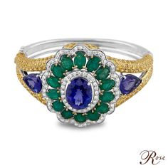 """""""A contemporary bracelet features Tanzanites, Emeralds, Yellow Sapphires and brilliant cut Diamonds set in 18K White Gold"""