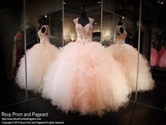 The champagne sweetheart bodice is embellished with beautiful blush details and has cap sleeves cascading into a button-up illusion back. The full skirt features an array of champagne and blush ruffles. Unbelievably beautiful and perfect for quinceanera, pageant or prom and it's at Rsvp Prom and Pageant, your source for 2016 prom, pageant and quinceanera dresses!