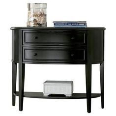 """Whether you want to update your living room or refresh your master suite décor, give your home a stylish uplift with this beautiful design. Product: Console table     Construction Material: MDF and rubberwood    Color: Antique black       Features:   Classic bowed front  Transitional lines  Two gently curved drawers with raised molding and wood knobs      Dimensions: 32""""  H x 38""""  W x 14.5""""  D            Shipping: This item ships small parcelExpected Arrival Date: Between 04/08/2013 and…"""