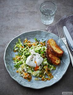 Spicy cabbage and noodle salad with poached egg