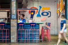 Hot pink industrial bar stools mix with pop art in this Atlanta Restaurant, Recess. Warm Industrial, Industrial Bar Stools, Industrial Flooring, Industrial Farmhouse, Industrial House, Industrial Bathroom, Industrial Bookshelf, Industrial Windows, Industrial Restaurant