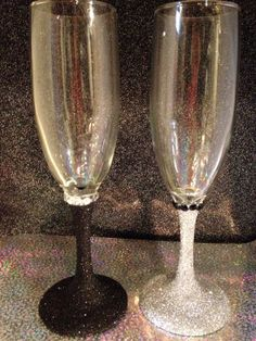 Bride and groom silver and black glitter champagne flutes set with rhinestones