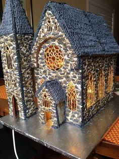 Gingerbread Cathedral - gingerbread, poured sugar, royal icing. Stained glass windows are made of hard crack sugar and food colouring, piped with icing, painted with 24k gold highlighter. Stone is 3 tone grey royal icing.