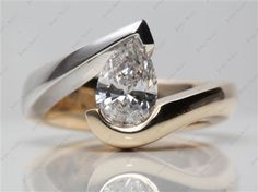 14k Two-Tone White and Yellow Gold Pear Shaped Swirl Tension Setting with Pear 1.02 Carat E SI1 Very Good Cut Diamond.