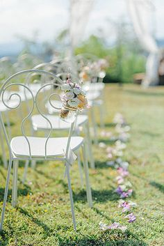 Ceremony chair decoration with mason jars and flowers