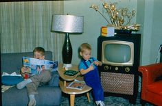 1959 Living Room   Notice how there's a tv but it's off and the kids are playing and reading. Hmmm, what a concept.