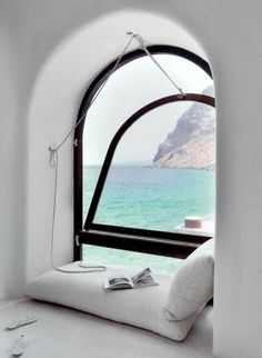 A reading nook with a view of the ocean