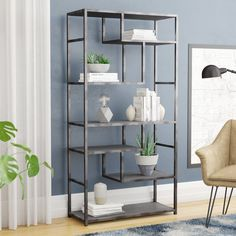 Certainly not just for corralling your collection of reads, this etagere bookcase adds decoration and display space to any ensemble. Measuring 65'' H x 33.1'' W x 13.4'' D overall, its manufactured wood frame is understated with a clean-lined silhouette finished in gray. The six shelves inside are what really make this piece pop, offering different sizes for a variety of ways to stage framed family photos and small potted plants.