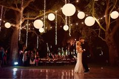 Paper lanterns are nice mixed with string lights. It looks like lights are hanging vertically, too.