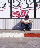 Homeless teen with graffiti