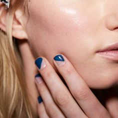 Naomi Yasuda for Essie created this negative space mani with a different design on each nail using Aruba Blue, Go Overboard and Master Plan.