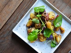 Roasted potatoes with brown mustard seeds and upland cress