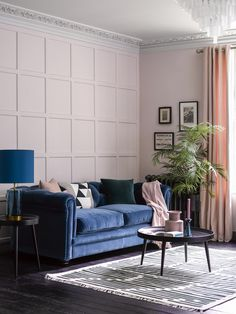 living room | home decor | house decoration | blue couch | pink curtains | elegant | classy | panel wall