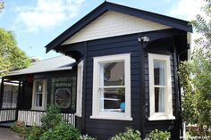 Exterior painted with Resene Black with Resene Double Pearl Lusta windows
