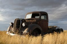Gimme a break. Old rusty truck, grey sky AND yellow wheat field?