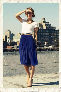 white shirt, long blue skirt