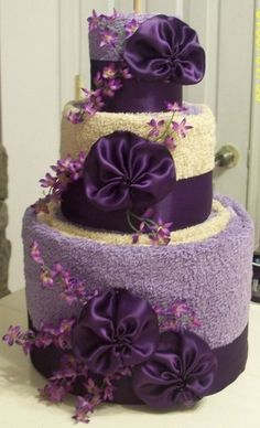 Торт из полотенец фиолетовый