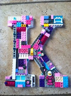 """Monogram wall:  Only a """"J"""" but in girly colors.  Custom mosaic letter. K toy bricks by MosaicTreasureBox on Etsy, $65.00"""