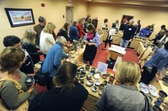 PNJ   1.19.14 - The crowd pics out hand made bowls Saturday during Manna Food Pantries' 7th Annual Fill a Bowl for Manna fund raiser at Pensacola State College's Jean and Paul Amos Performance Studio.