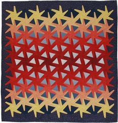 Triangle Tessellation by Gail Garber.  Careful placement of gradated fabrics gives this quilt at 3D look.