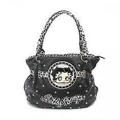 This Official Betty Boop® Metal Studded Handbag features: - Betty's Logo images w/Metal Studs On front - Double Handle Shoulder Strap - Zip Top Closure - One Wall zipper - Two pouch pockets Inside - O