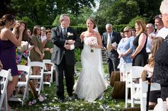 Father of the bride looks cheerful as he escorts his daughter down the aisle. Wedding Planner: Perfect Planning Events.