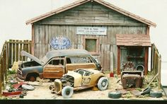 Old, damaged cars diorama.
