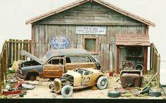 Old, damaged cars diorama.