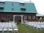 wedding if done on side of barn with arbor