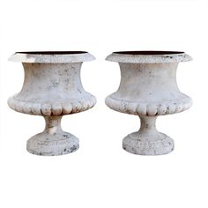 A Pair of French Nineteenth Century Cast Iron Urns | From a unique collection of antique and modern planters and jardinieres at http://www.1stdibs.com/furniture/building-garden/planters-jardinieres/
