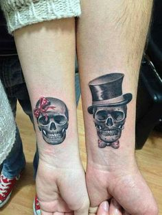 Skull tattoos for a couple.
