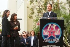 Tom Hanks delivers a tribute during George's star ceremony on the Walk Of Fame