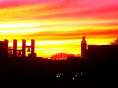 The Burleson Bells [remaining carillon bells from the Old Main Building] and the Main Tower at sunset, UT Austin