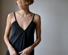 Bias cut, flowing top with  v front and low v back in black synthetic silk, adjustable straps, boho, evening or casual. One size, via Etsy.